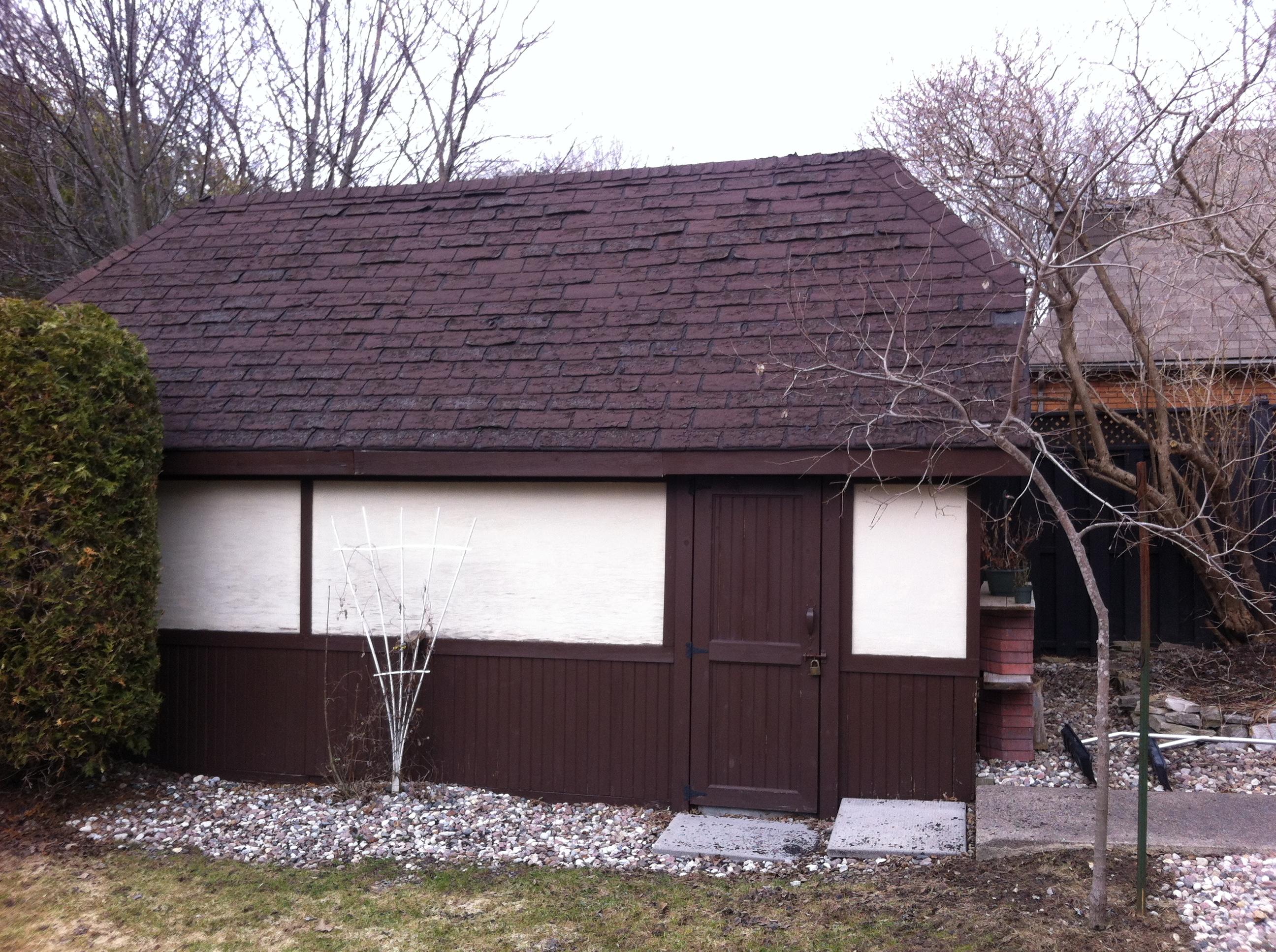 Detached garage reroof before